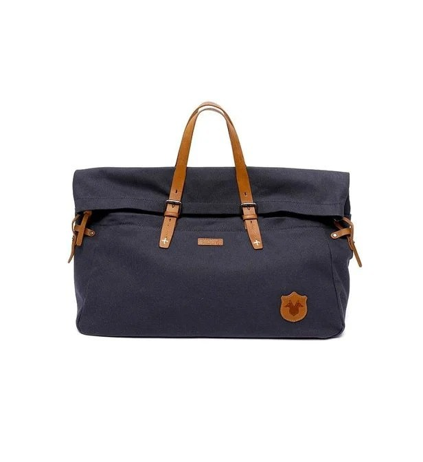Sac 48h en toile bleu marine avec détails en cuir marron, Kost Paris, 80€ au lieu de 160€.